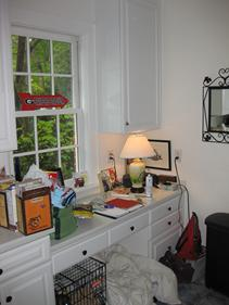 Before the remodel - a desk in the kitchen is unused and not practical.